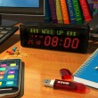 Digital alarm clock on table — Stockfoto