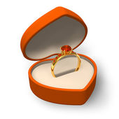 Orange heart-shape box with golden ring with jewels — Stock Photo