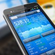 Stock market application on smartphone — Stockfoto
