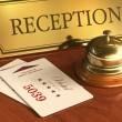 Service bell and cardkeys on hotel reception desk — Stockfoto #8892875