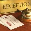 Service bell and cardkeys on hotel reception desk - Stock Photo
