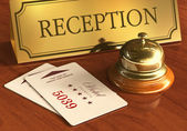 Service bell and cardkeys on hotel reception desk — Stockfoto