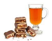 Pile of broken chocolate and tea — Stock Photo