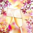 Orchid and champagne flutes — Stock Photo