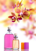 Perfume and yellow orchid — Stock Photo