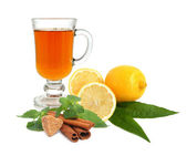 Tea with lemon, sugar, cinnamon and mint — Stockfoto