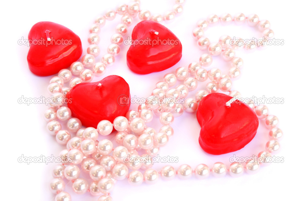 Heart shape red candles and necklace isolated on white background. — Stock Photo #8079693