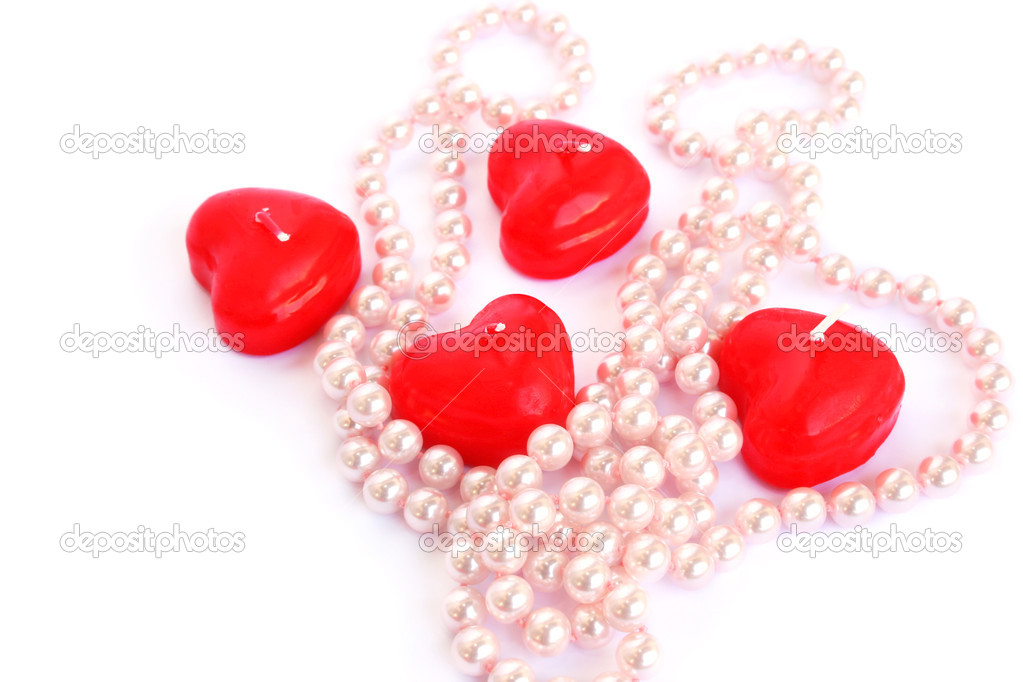 Heart shape red candles and necklace isolated on white background. — Stock Photo #8079706