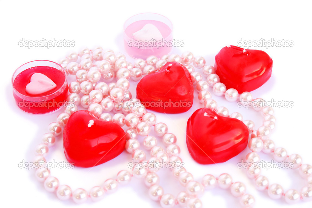 Heart shape red candles and necklace isolated on white background.  Stock Photo #8079736