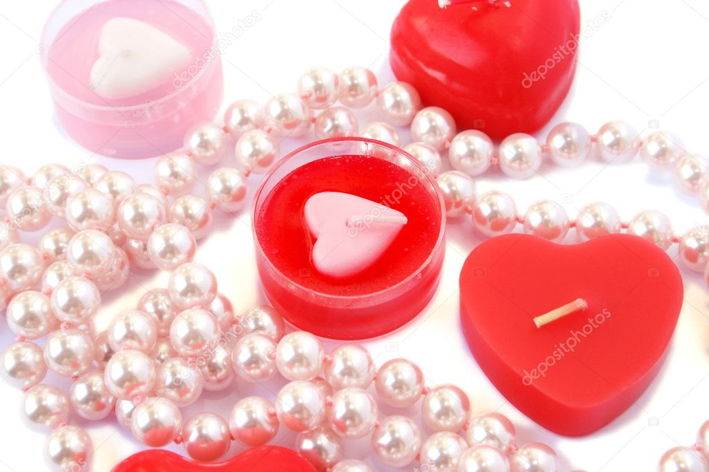 Heart shape red candles and necklace isolated on white background. — Stock Photo #8079804