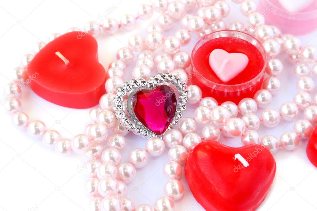 Heart shape red candles, stone and  necklace  on white background.  Stock Photo #8079880