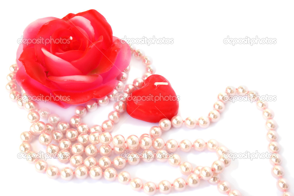 Heart and rose shape red candles, necklace isolated on white background.  Stock Photo #8079963