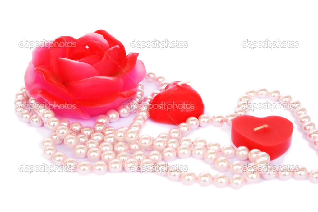 Heart and rose shape red candles, necklace isolated on white background.  Stock Photo #8079981