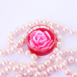 Stock Photo: Rose candle and necklace