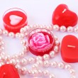 Stock Photo: Red candles and necklace