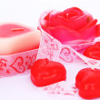 Red candles and ribbon — Stock Photo