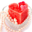 Red candle and necklace — Stock Photo