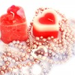 Red candles and necklaces — Stock Photo