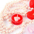 Royalty-Free Stock Photo: Red candles and necklace