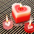 Red and pink candles - Foto Stock