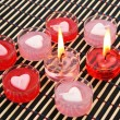 Stock Photo: Red and pink candles