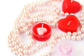 Red candles and necklace — Стоковое фото
