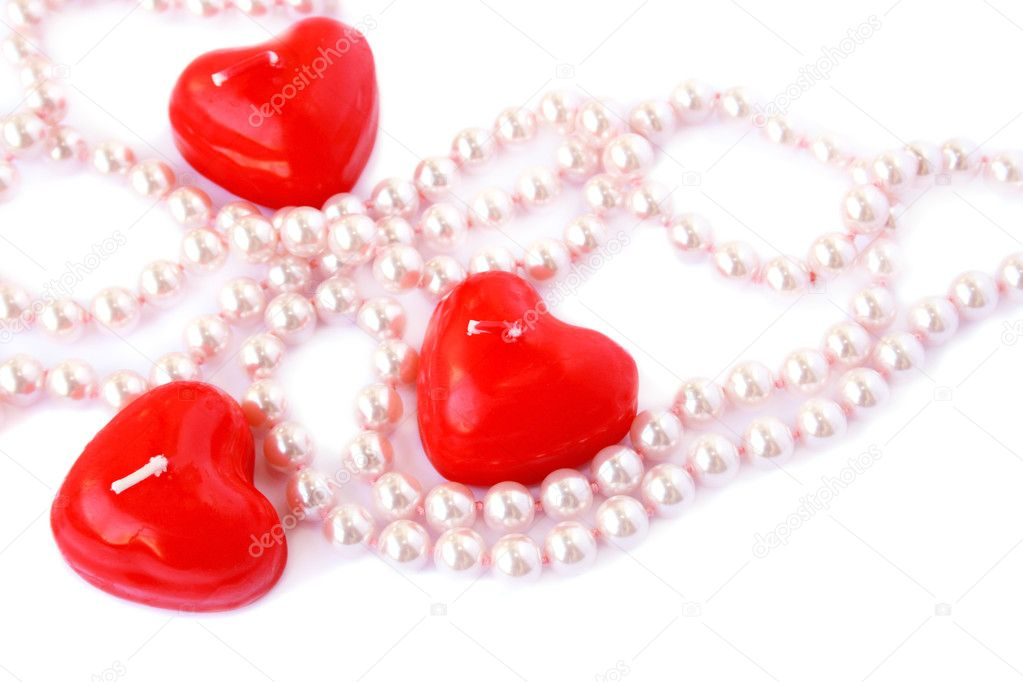 Heart shape red candles and necklace isolated on white background. — Stock Photo #8080091