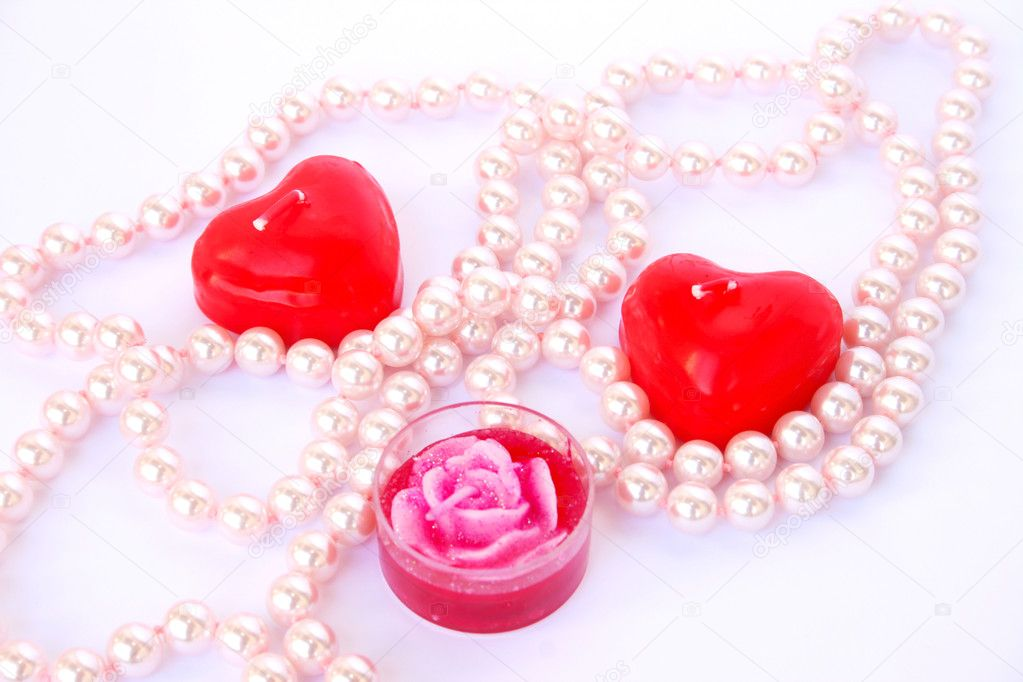 Heart shape red candles and necklace isolated on white background. — Stock Photo #8080141