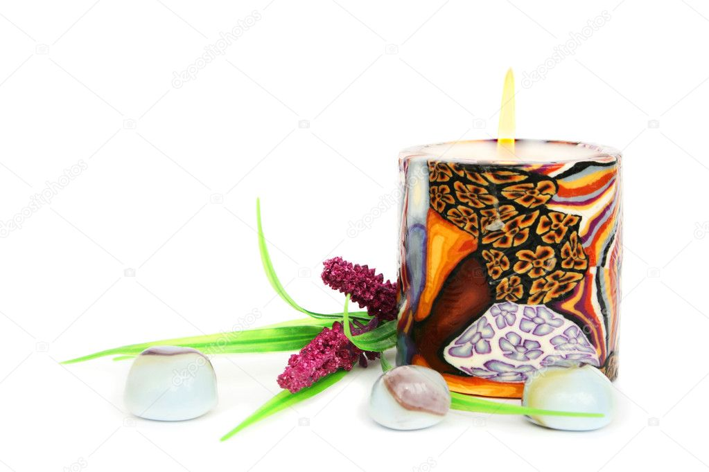Colorful burning candle, stones and plant isolated on white background. — Stock Photo #8794585