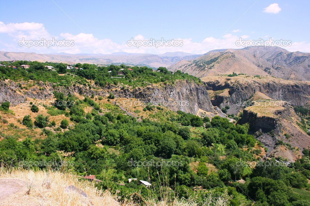 Armenian landscape with mountains and village.  Stock Photo #8850673