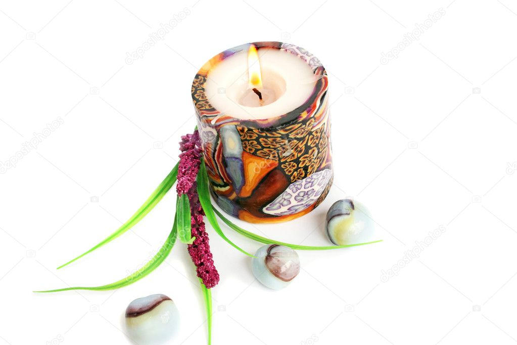 Colorful burning candle, stones and plant isolated on white background. — Stock Photo #8855195