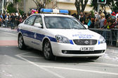 Police car in carnival — Stock Photo