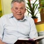 Senior man reading book — Stock Photo