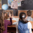 Male teacher in front of elementary age pupils — Stock Photo