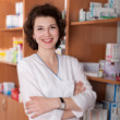 Chemist in drugstore — Stock Photo