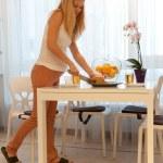 Pregnant woman in kitchen — Stock Photo #8404315