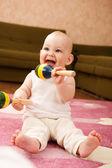 Baby girl playing — Stock Photo