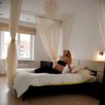 Pregnant in luxury bedroom — Stock Photo