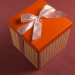 Present box on textile background — Stock Photo