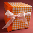 Present box on textile background — Foto Stock
