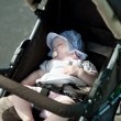 Sleeping baby in stroller — Stock Photo
