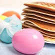 Easter eggs and pancakes — Stock Photo