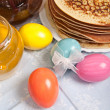 Easter eggs and pancakes - Stock Photo