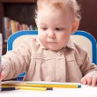 Foto Stock: Baby drawing