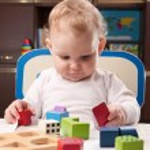 Baby with toy blocks — Stock Photo