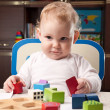 Baby with toy blocks — Stock Photo
