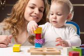 Mother and baby daughter building tower — Stok fotoğraf