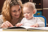 Mother and baby reading — Stock Photo