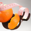 Orange peel and measuring tape — Foto de Stock