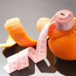 Orange peel and measuring tape - Stock Photo